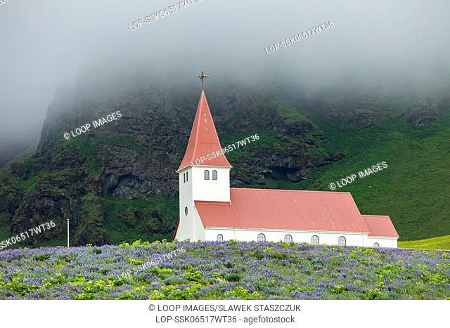 Misty summer morning at the church in Vik