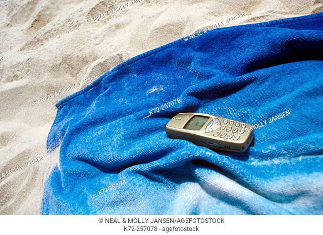 cell phone on beach towel