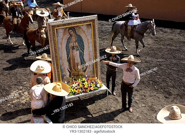 Charros carry an image of the Our Lady of Guadalupe during a rodeo competition in Mexico City, November 16, 2008