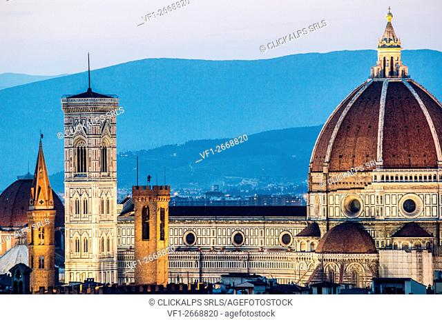 Florence, Tuscany, Italy. cityscape and Cathedral and Brunelleschi Dome, Giotto Tower. Sunset, lights on