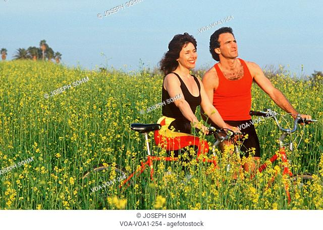 Couple resting during bicycle ride