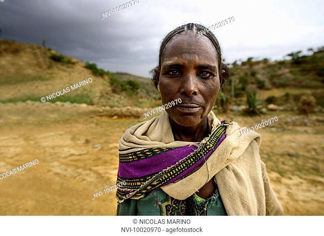 Tigrayan woman with typical Ethiopian orthodox tattoos on foreheads, Ethiopia