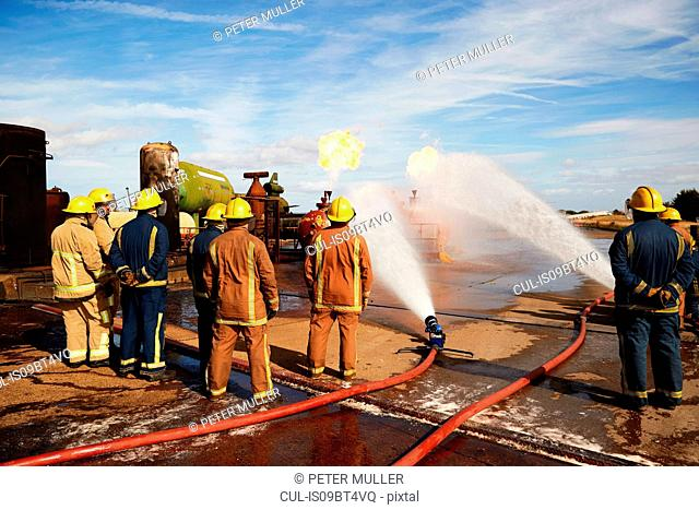Firemen training to put out fire on burning tanks, Darlington, UK