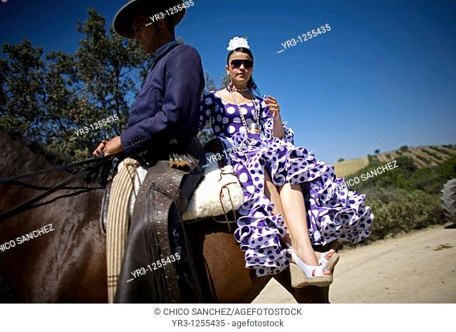 Riders wear traditional Andalusian clothes during a romeria, or pilgrimage, in honor of San Isidro Labrador, the patron of farmers, in Prado del Rey village