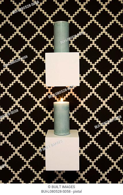 Candle display hung on wall with printed wall paper