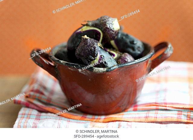 Aubergines in an enamel pot