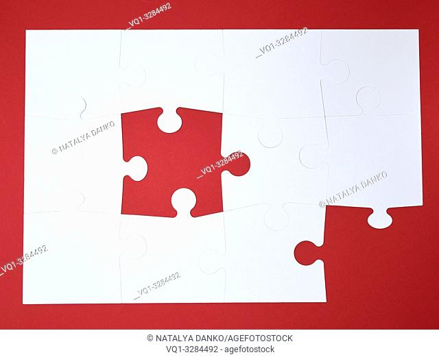 white large blank puzzles on a red background, top view