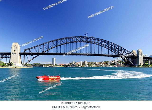 Australia, New South Wales, Sydney, Harbour Bridge, red speedboat passing through the bay of Sydney