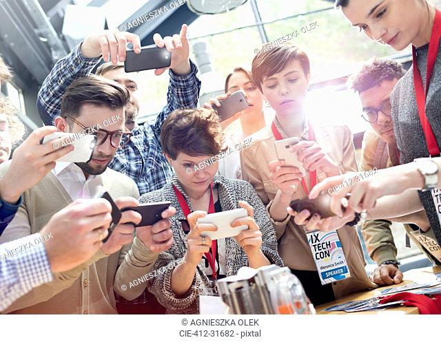 Crowd using camera phones at technology conference
