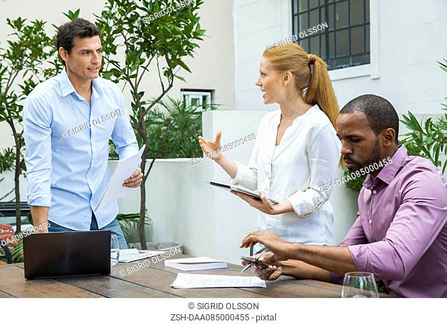 Businesswoman explaining idea to colleagues at meeting