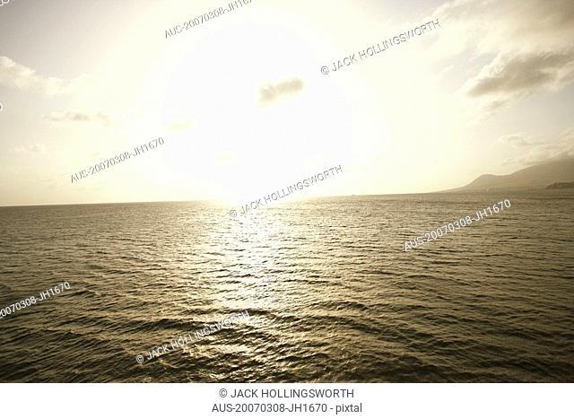 Sun shining over the sea