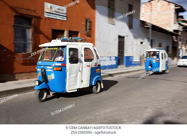 Dynamic scene of the Coco taxis-Bici Taxis in the city center, Cajamarca, Northern Highlands, Peru, South America