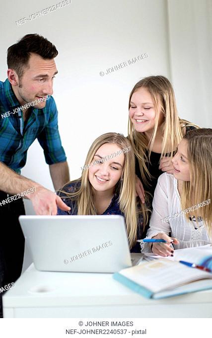 Girls with teacher