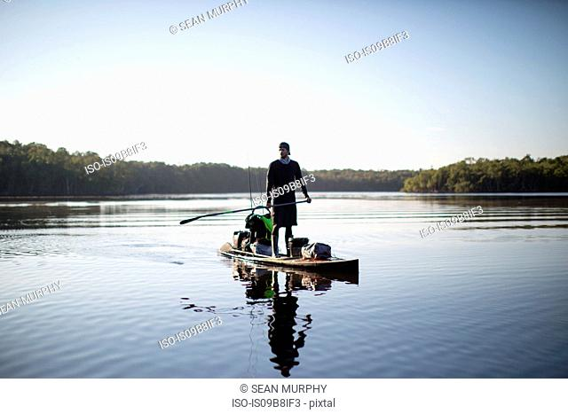 Man paddle boarding on water