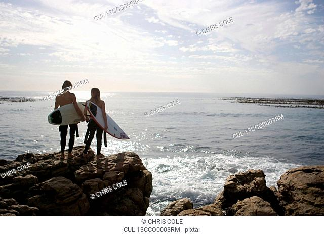 Young couple prepare to go surfing