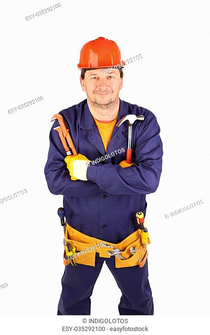 Worker in hard hat holding hammer and pliers. Isolated on a white background