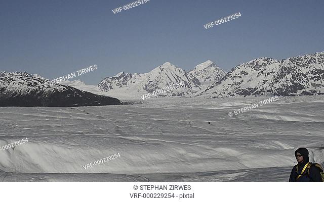 WS TS TU TD Man walking on snow in colony glacier, Alaska