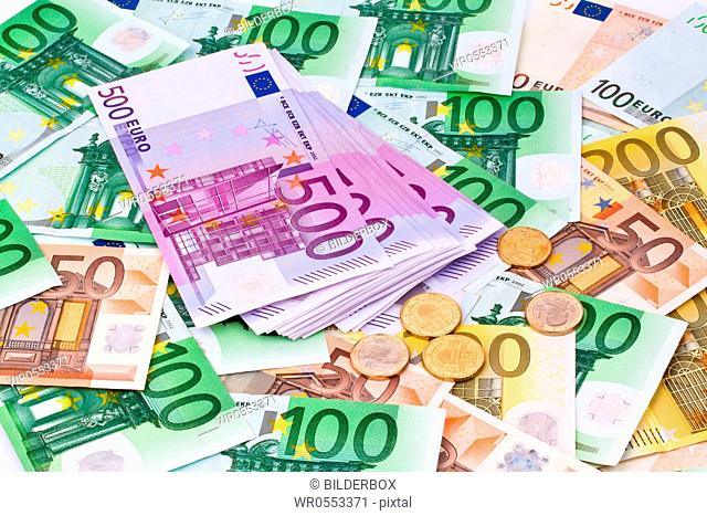 Many euro banknotes of the European Union lie side by side