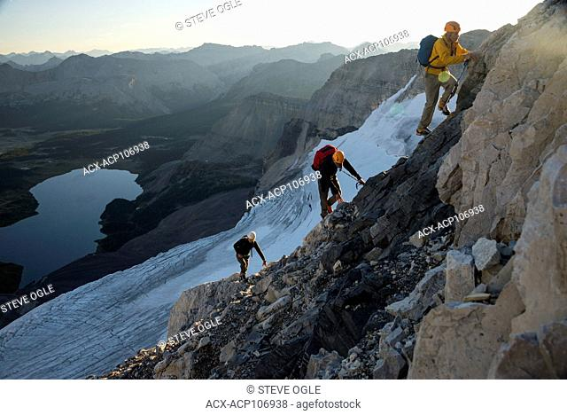 Three male climbers ascending the north ridge of Mount Assiniboine, British Columbia