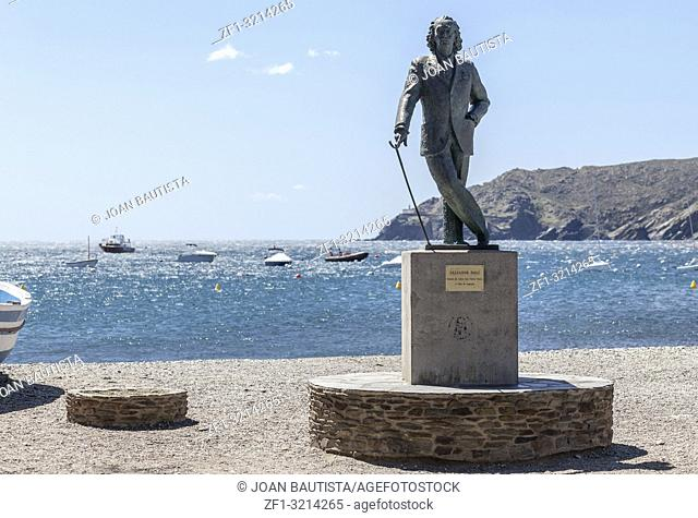 Beach view and sculpture Salvador Dali by sculptor Ros Sabate, in Cadaques,village of Costa Brava