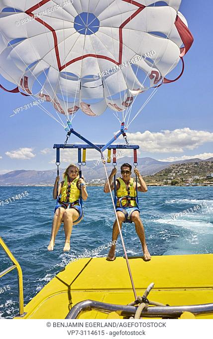 Couple during parasailing. Chersonissos. Crete, Greece