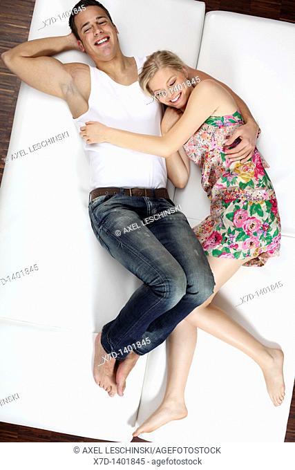 couple lying on sofa