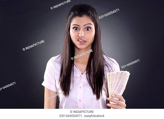 Portrait of businesswoman with currency