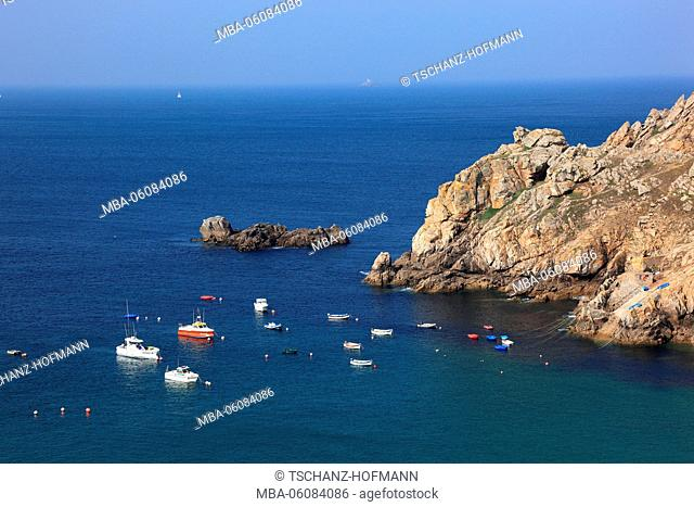 France, region of Brittany, on rocky Cap Sizun, boats in the bay Baie des Trepasses