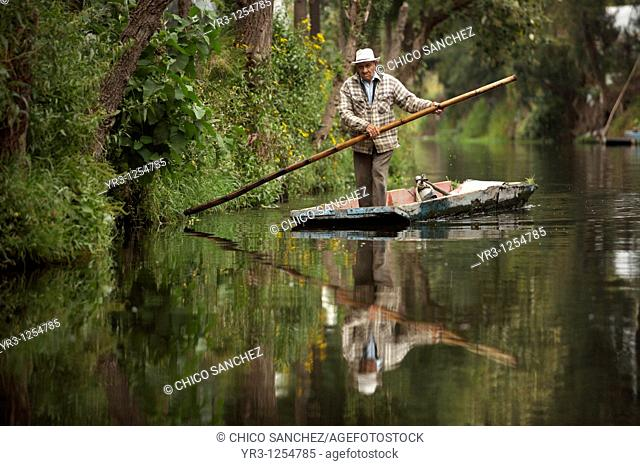 A farmer navigates through the water canals of San Gregorio Atlapulco village in Xochimilco, southern Mexico City