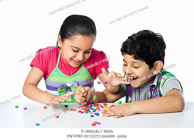 Children playing with candies