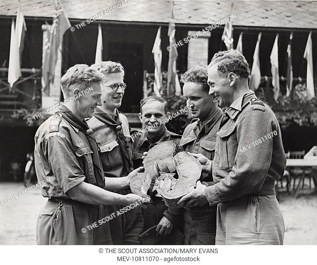A group of scouts at an International Scouts Camp, Youlbury, near Oxford, where ten countries were represented. Seen here are Polish scouts presenting English...