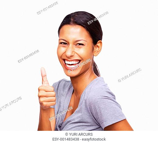 An attractive young woman smiling and showing thumbs up sign on white background