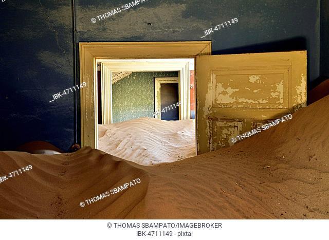 Desert sand in the ruined building of the former diamond city, ghost town, Kolmanskop, Lüderitz, Namibia
