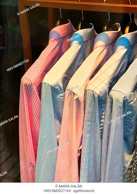 Shirts hanging in a shop window