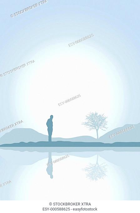 Silhouette of a solitary man by a lake