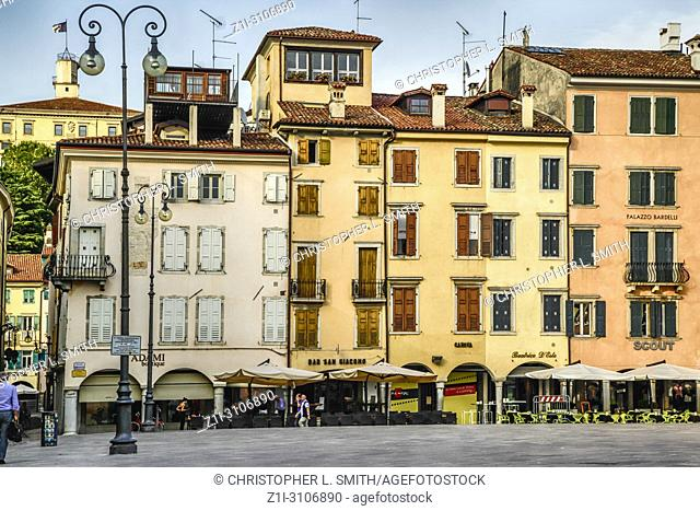 Restaurants and shops in Piazza San Giacomo in Udine, Italy