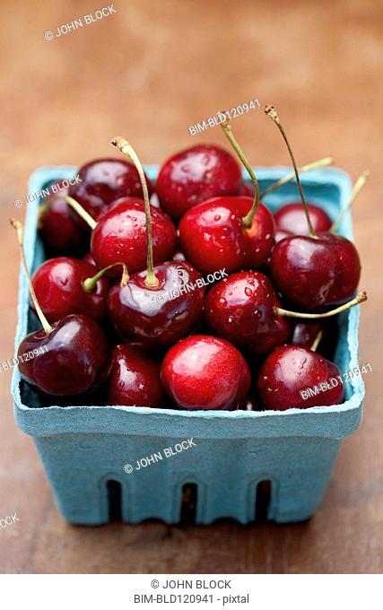 Close up of bing cherries in carton