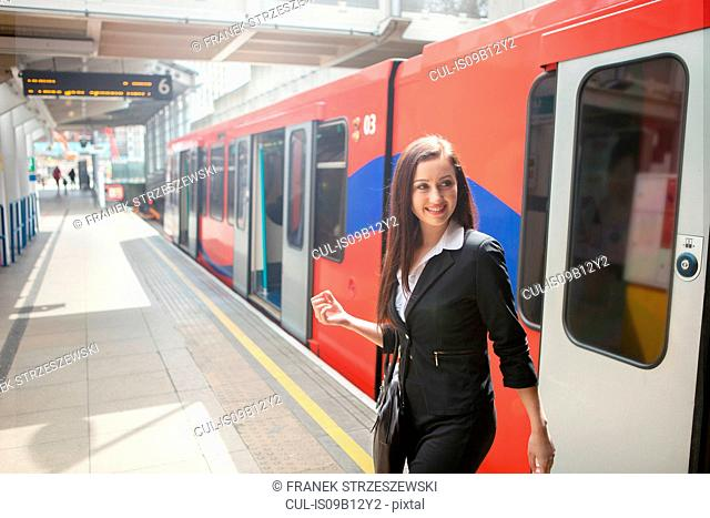 Businesswoman in Docklands Light Railway train, London