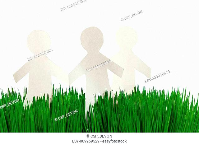 green grass and Paper Chain men