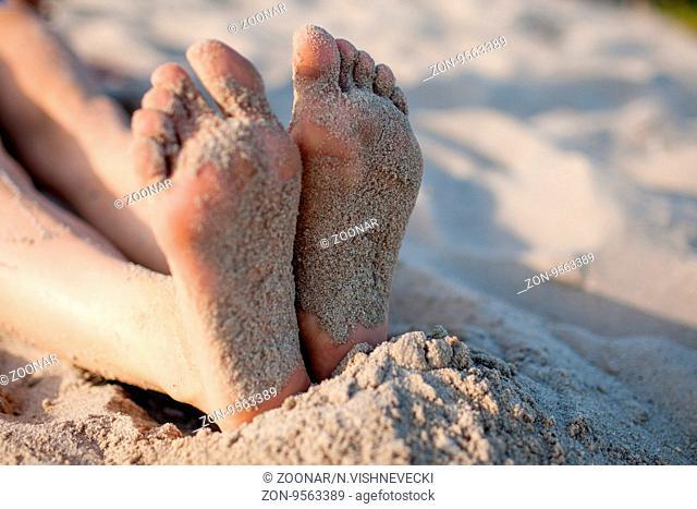 legs lying sunbathing young girl on sand