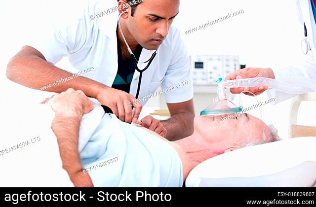 Serious doctor resuscitating a patient