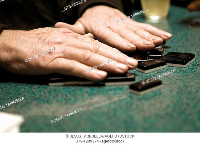 Hands of elderly man playing dominoes  Dominoes  Villena  Alicante  Spain  Valencia  Europe