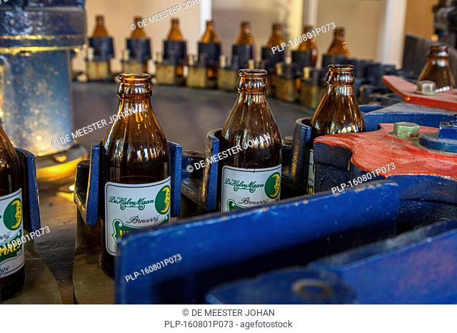Beer bottles on the assembly line of Brouwerij Henri Maes, Belgian brewery at Bruges, Belgium