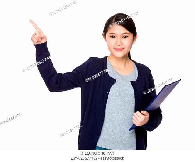 Young woman holding with clipboard and finger point up