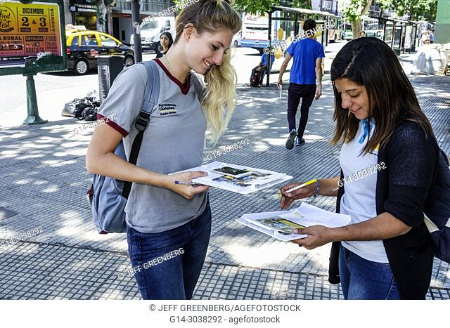 Argentina, Buenos Aires, survey questionnaire, woman, young adult, filling out completing answering, survey, sidewalk street, Hispanic