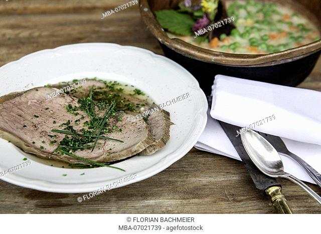 boiled beef with broth and chives
