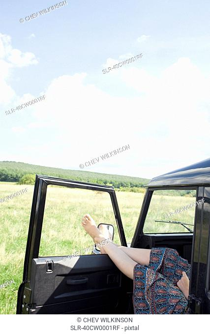 Woman relaxing in parked car