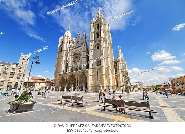 Tourist visiting famous landmark Leon Cathedral, Castilla y Leon, Spain. Leon Cathedral is a masterpiece of Gothic style