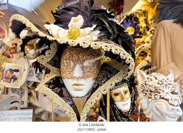 Ornate Venetian mask for Venice Carnival on display in shop window, Italy
