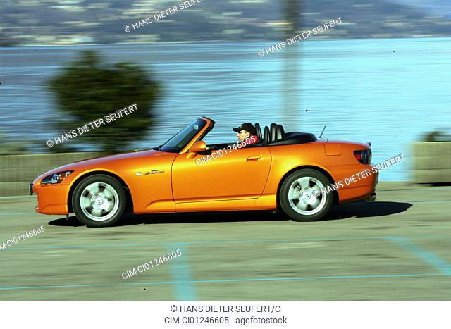 Car, Honda S 2000, model year 2005-, orange , Convertible, driving, side view, country road, open top